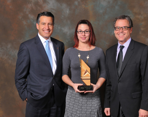 Nevada Governor Brian Sandoval (Left), Kylee Bozarth (Center), and Peter Gunnerman (Right) accepting a company award in December 2014.