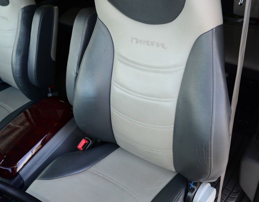 National's posh leather upholstery with perforated inserts dresses up the cockpit.